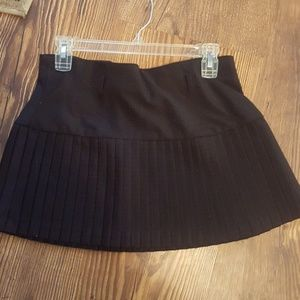 Pleated black red dotted mini skirt